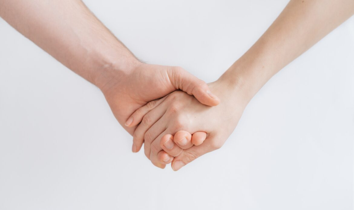 Two hands holding.