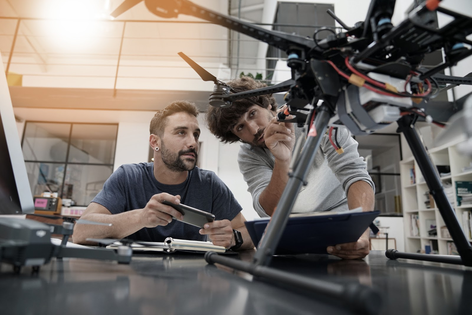 Two male engineers working on a drone