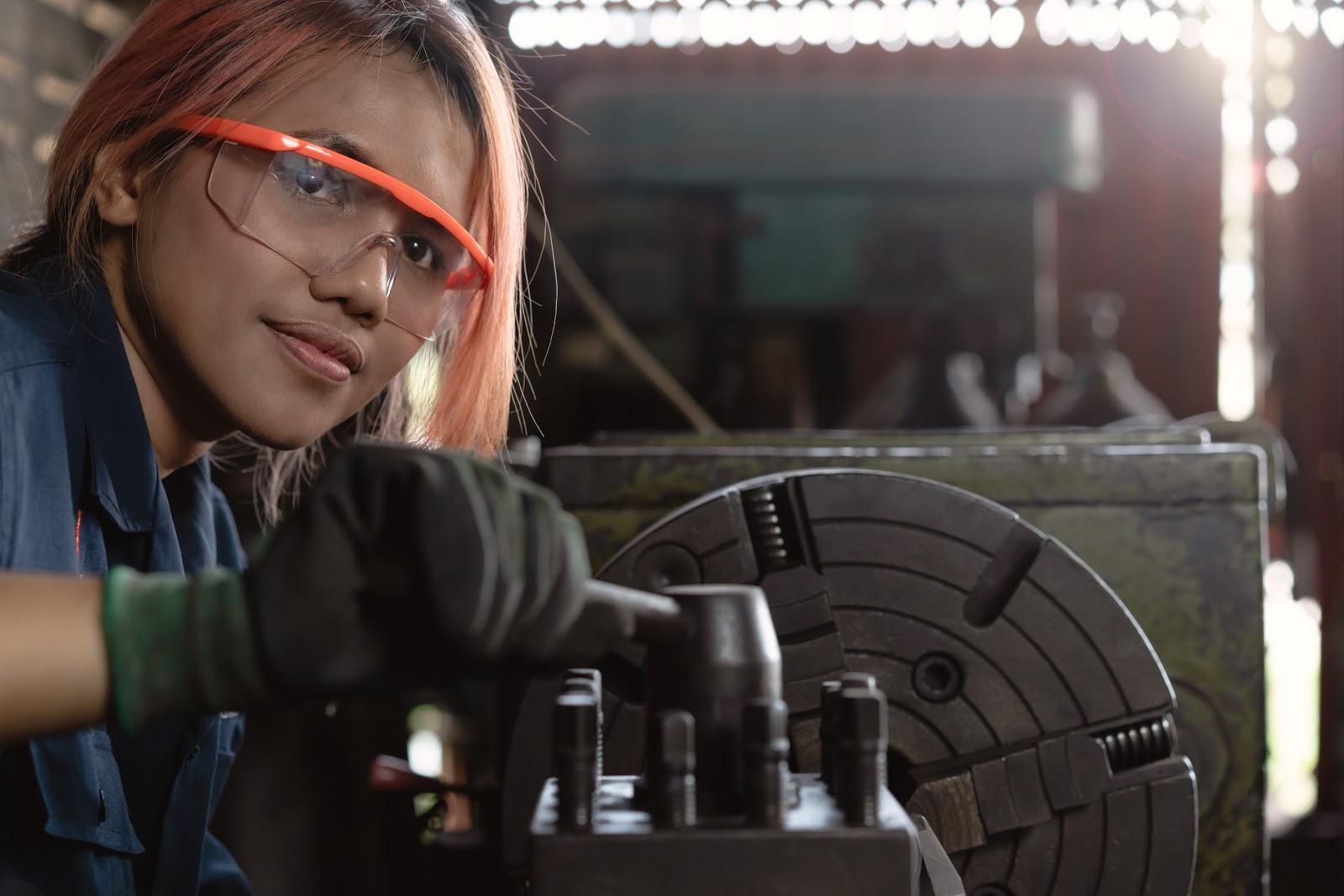 Female engineer wearing safety equipment while working
