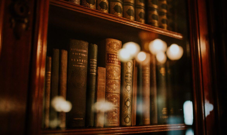Bookshelf with lights shining on the books