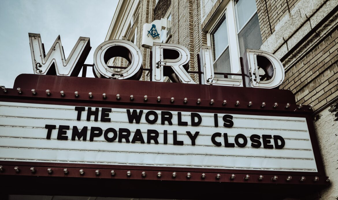 """Movie theater sign with the letters saying """"THE WORLD IS TEMPORARILY CLOSED"""" during the COVID-19 Pandemic."""