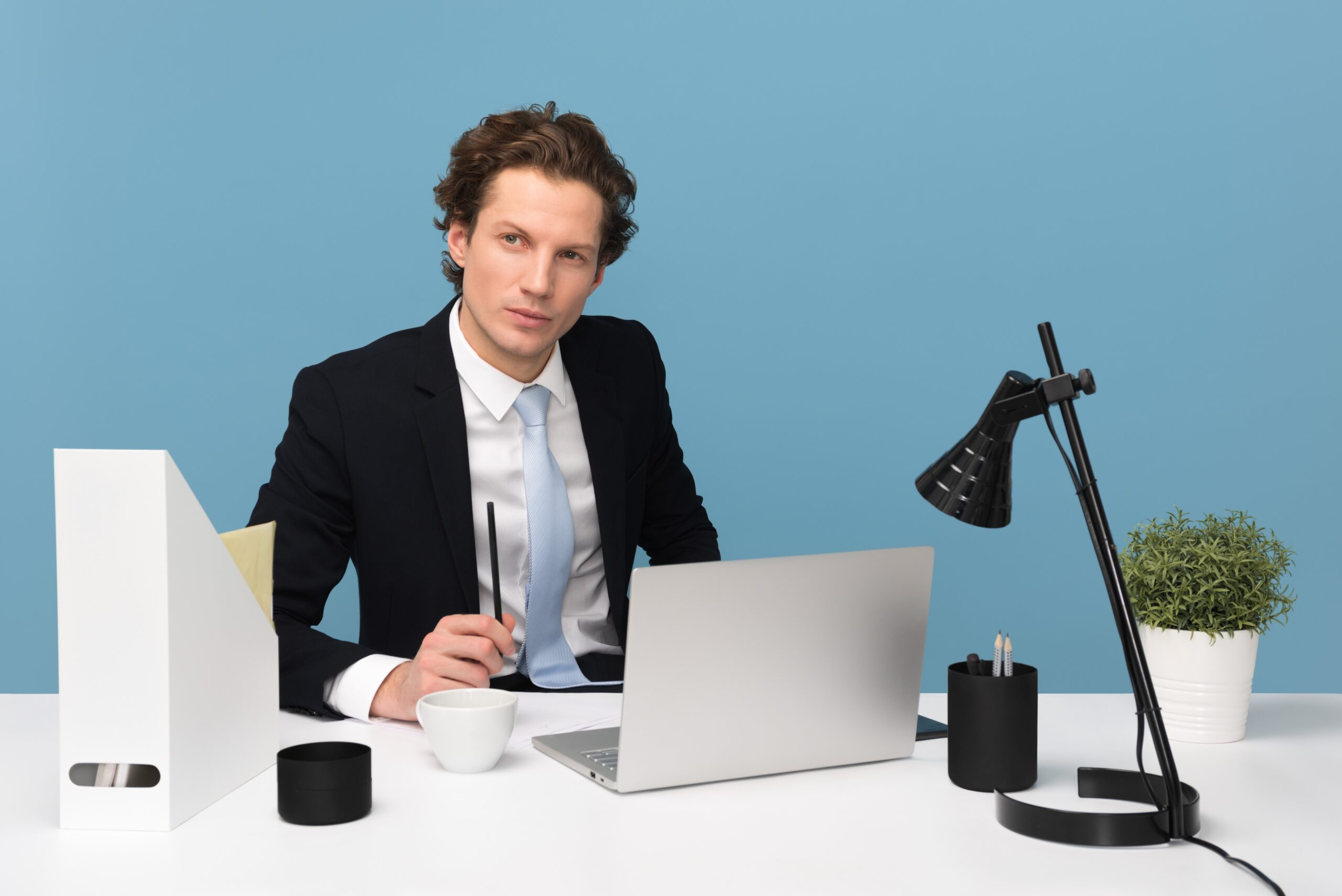 Man sitting at a desk, in deep thought