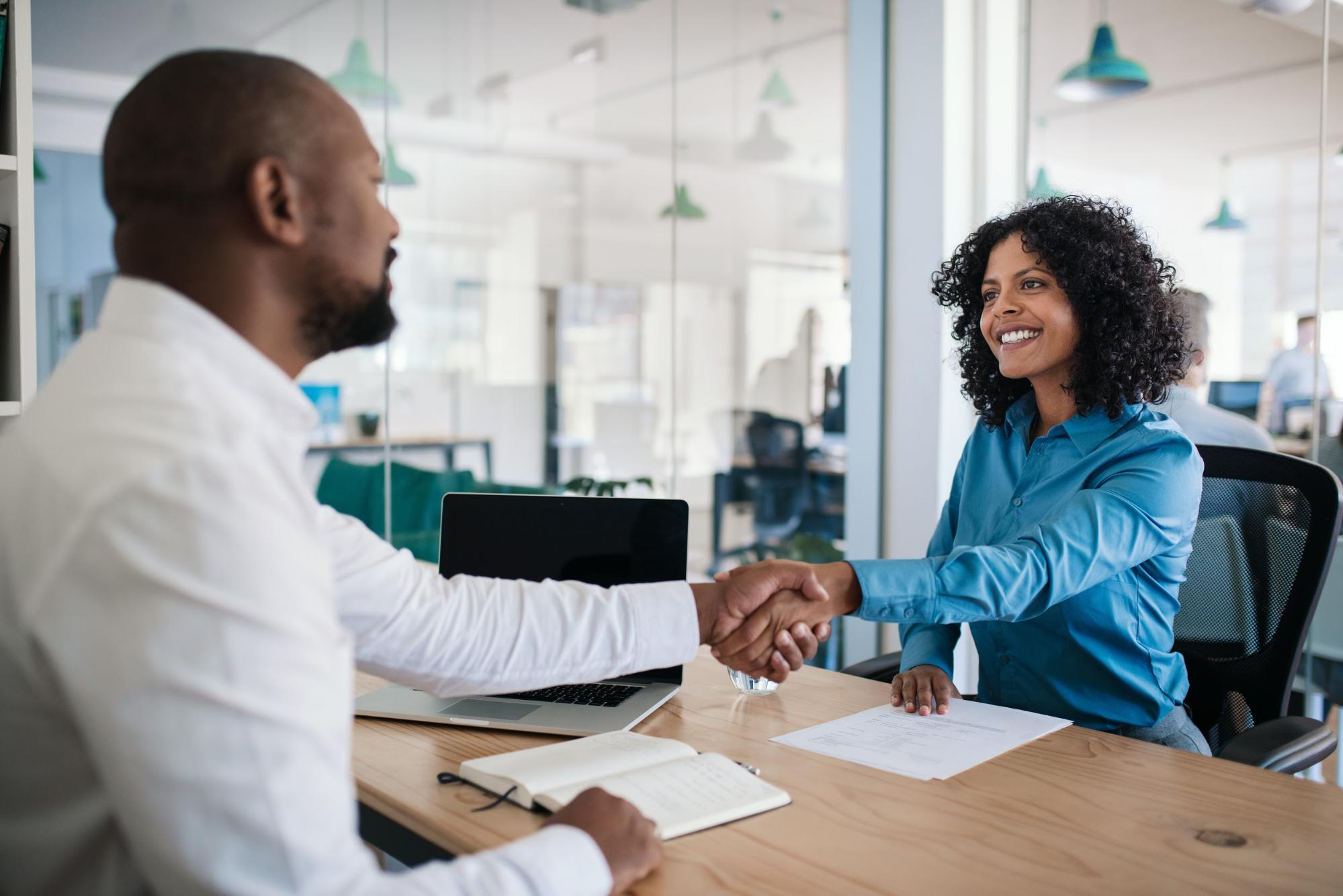 Man shaking hands with a female applicant