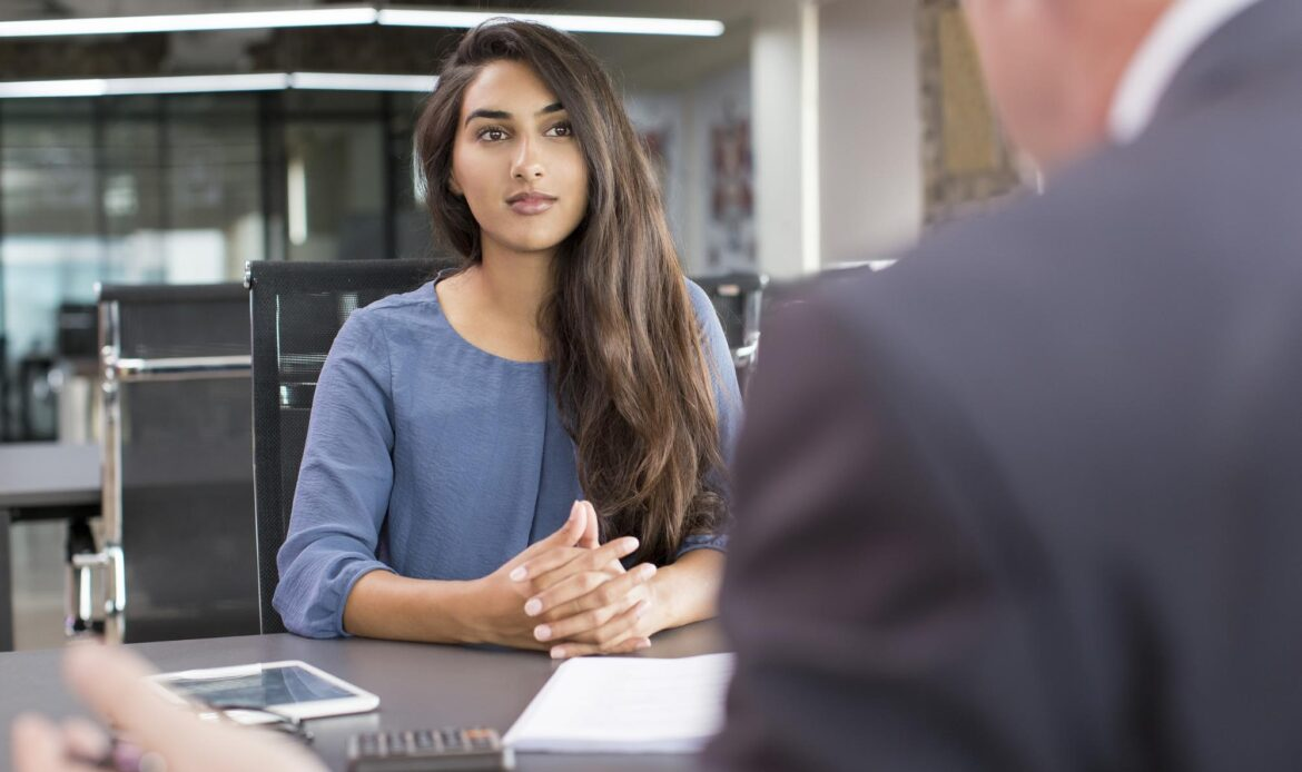Dell internships: woman sitting in front of a man
