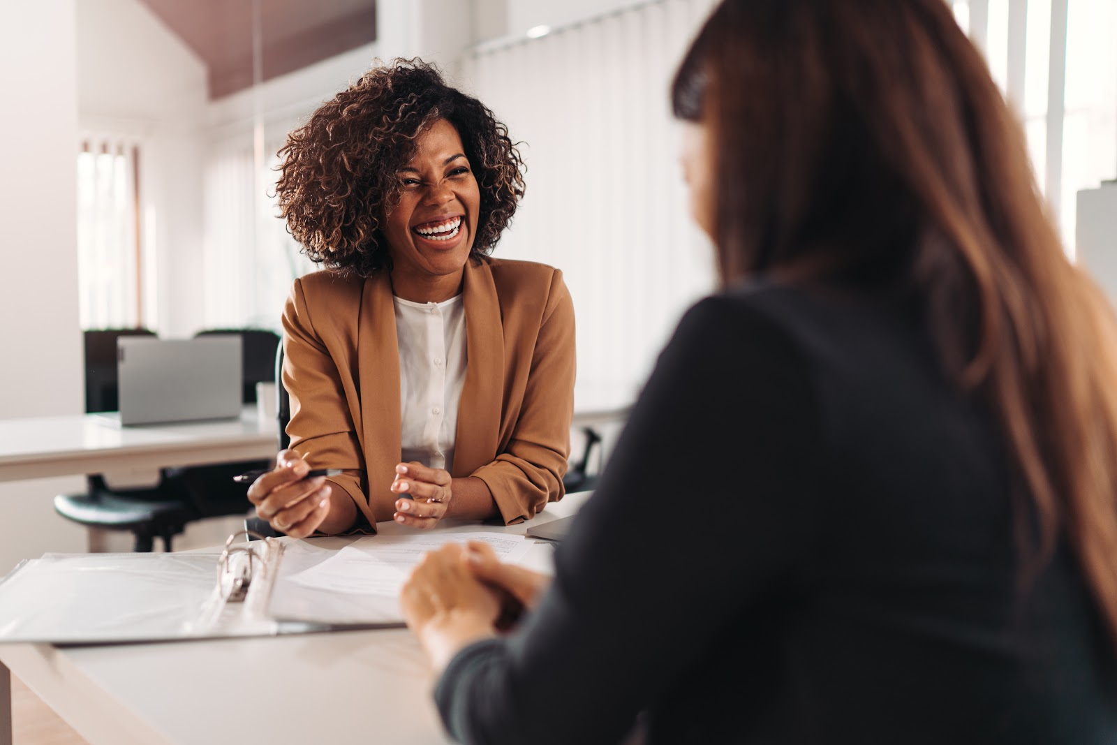 marketing interview questions: Interviewer laughing with the applicant during an interview