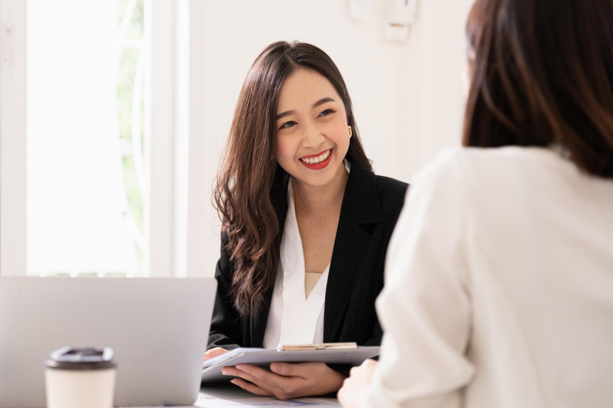 Interviewer smiling at an applicant