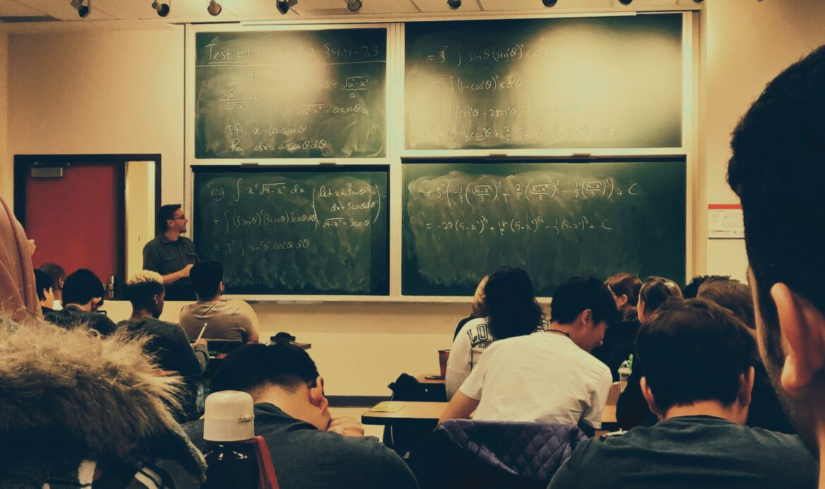A classroom of students learning a math-related topic.