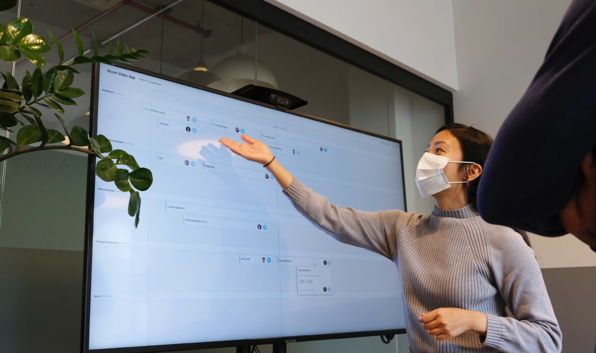 Woman pointing to an idea on a computer screen.