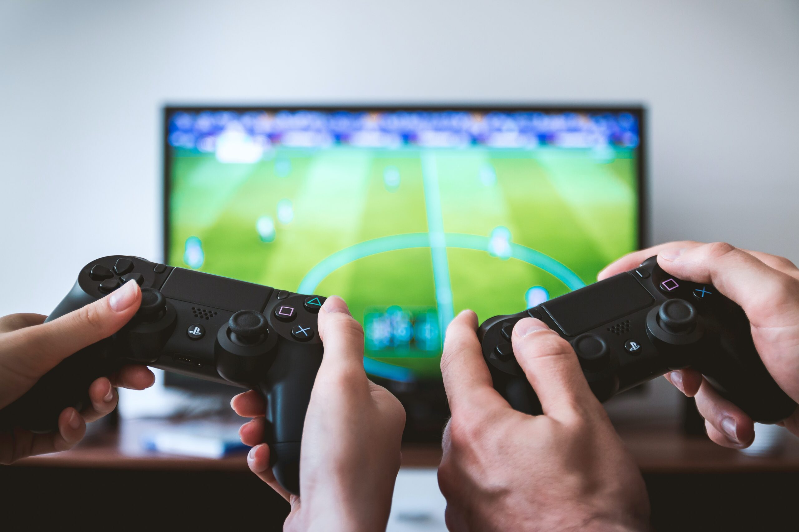 Two hands holding video game controllers