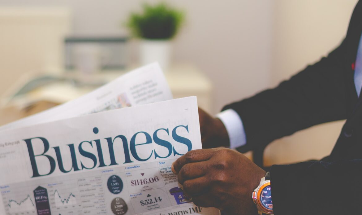 A man sitting and reading the Business news paper.