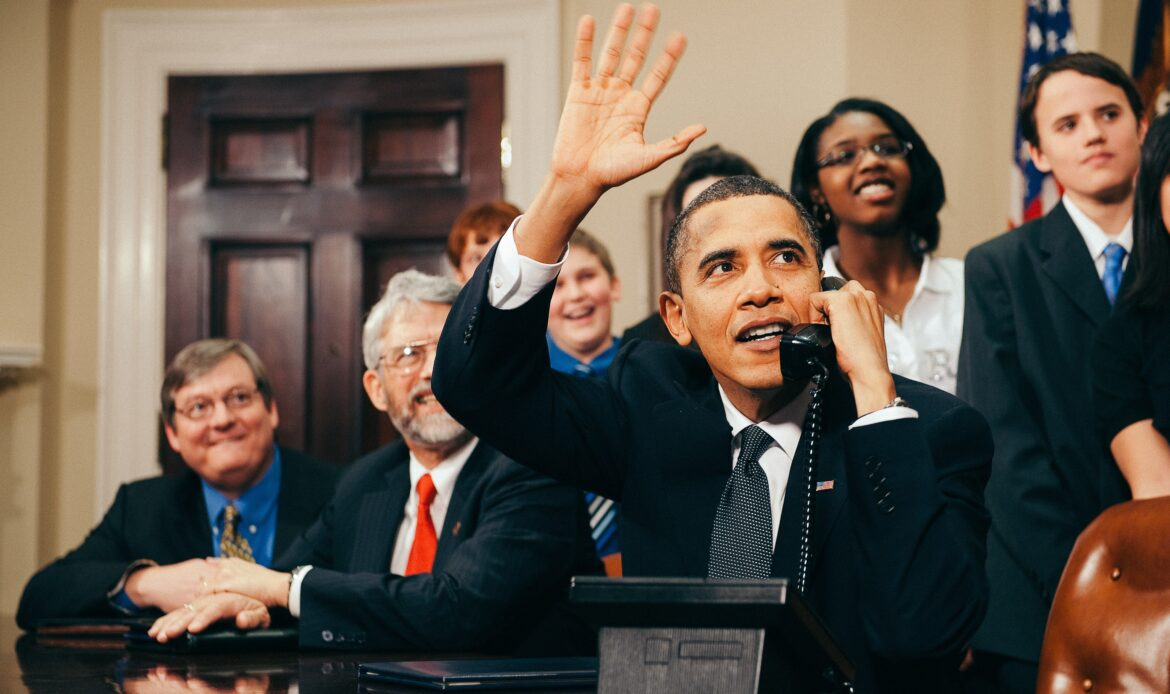 """From Unsplash: """"Feb. 17, 2010, U.S. President Barack Obama, accompanied by members of Congress and middle school children, waves as he talks on the phone from the Roosevelt Room of the White House to astronauts on the International Space Station."""""""