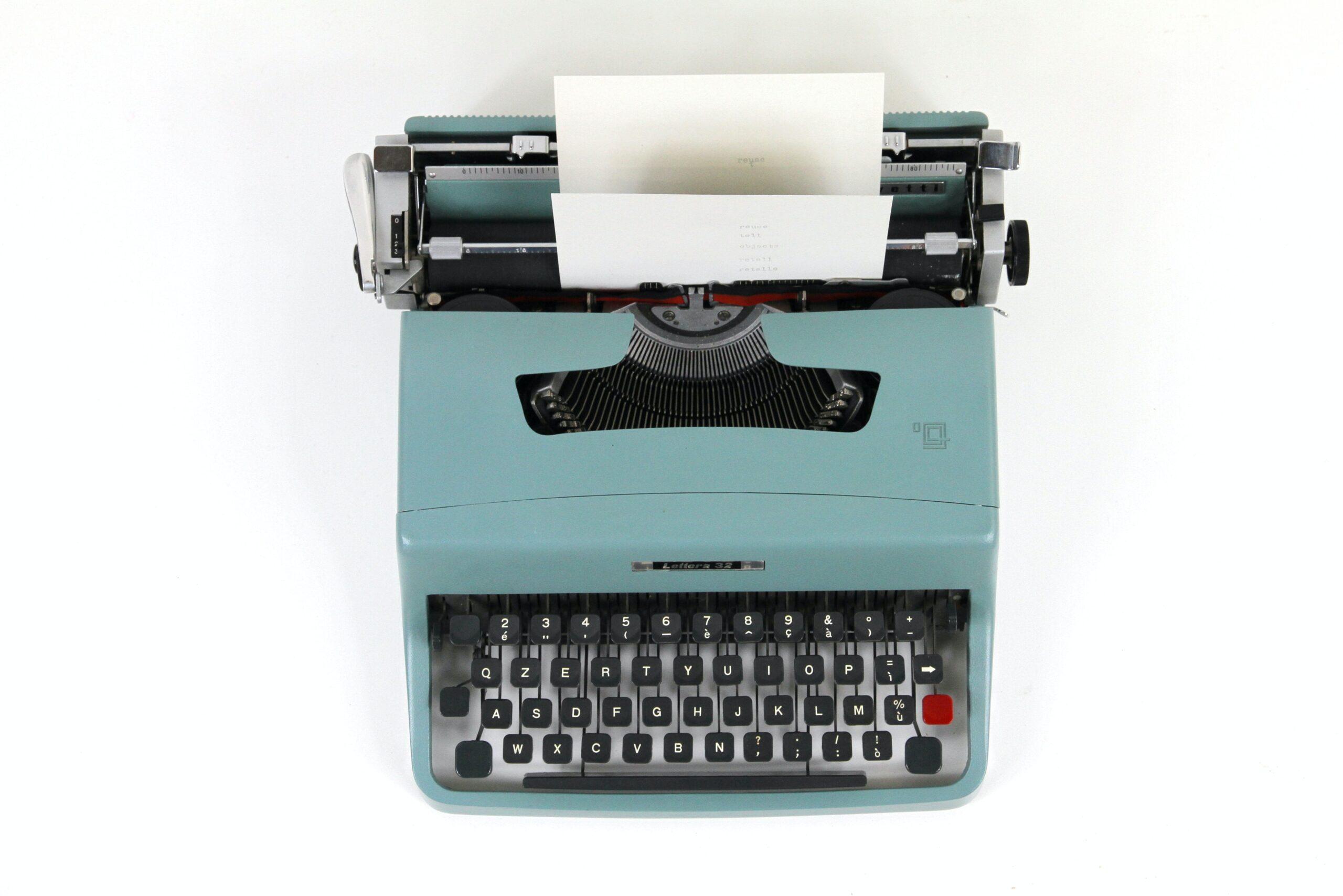 Blue typewriter typing something out