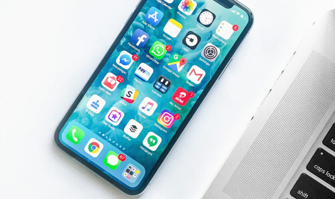 An iPhone home screen with a variety of apps such as Instagram, Google Hangouts, Facebook Messenger, Facebook, WhatsApp, Google Maps, and Gmail.