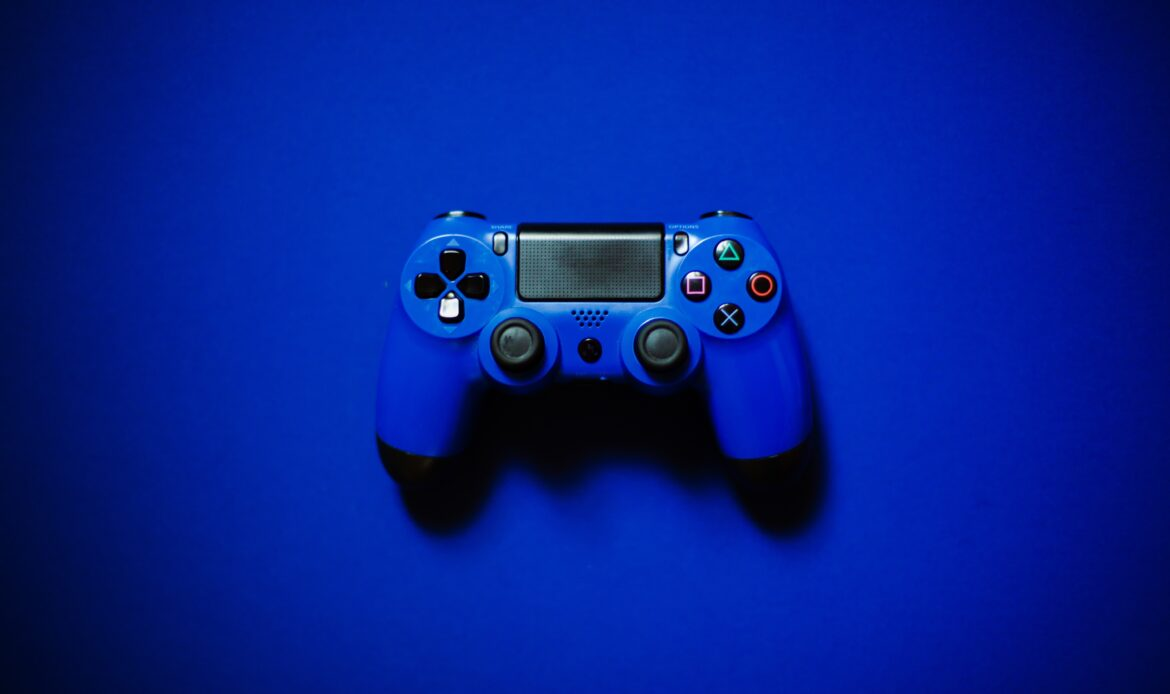 Blue Xbox controller on a blue background.