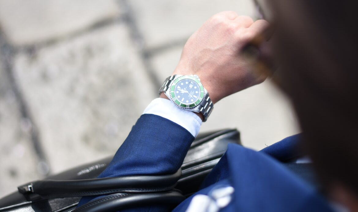 Man's arm, close up of his watch.