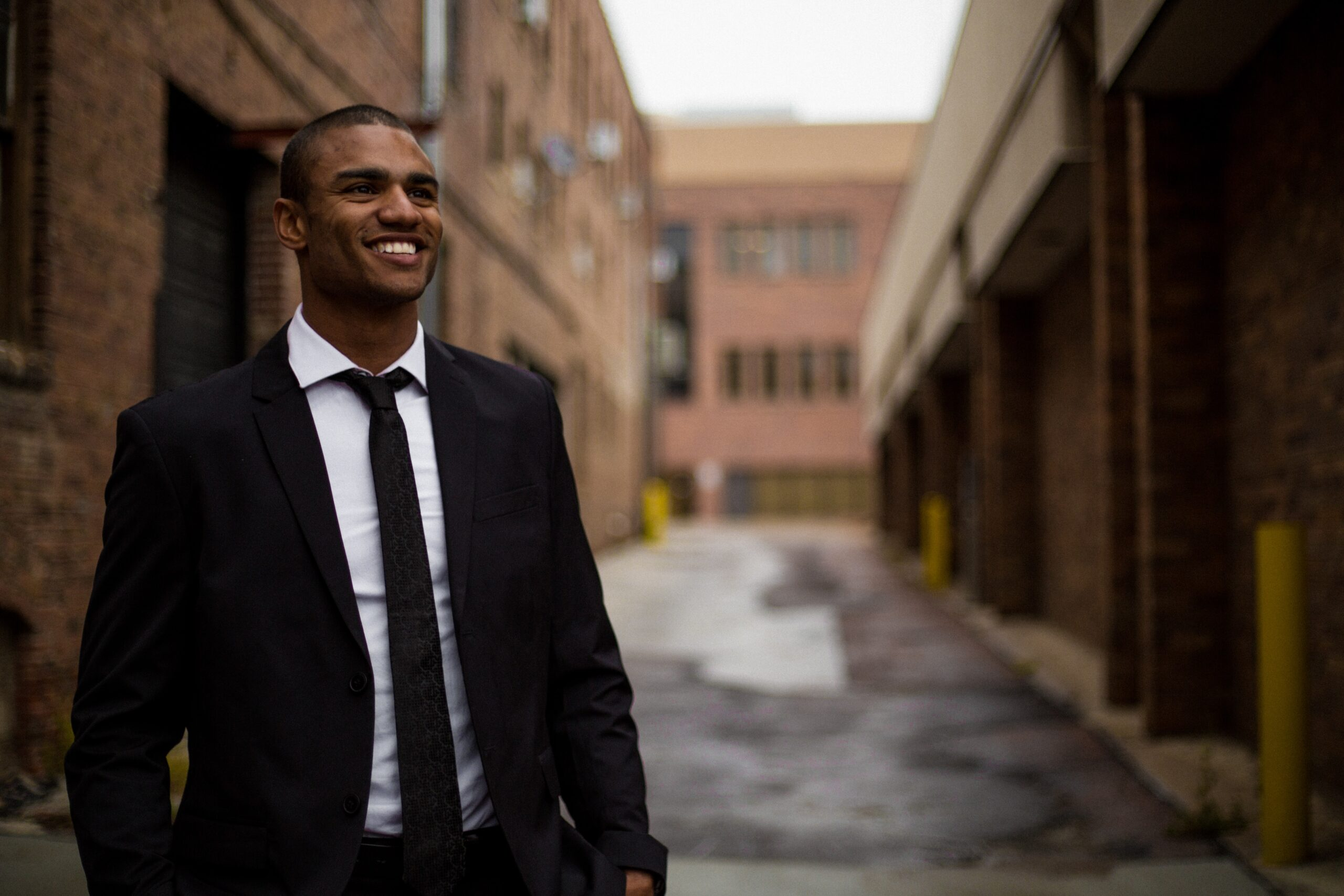 Man in a suit smiling