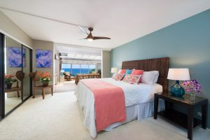 Puu Poa #313 Master Bedroom with King Sized Bed and Ocean Views through Atrium