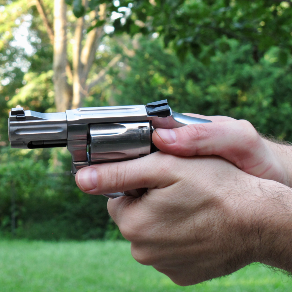 Thumbs-Forward Revolver Grip