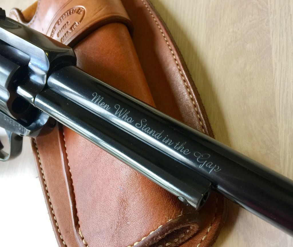 Handsomely engraved motto of The Shootists on the right side of the Bisley's barrel.