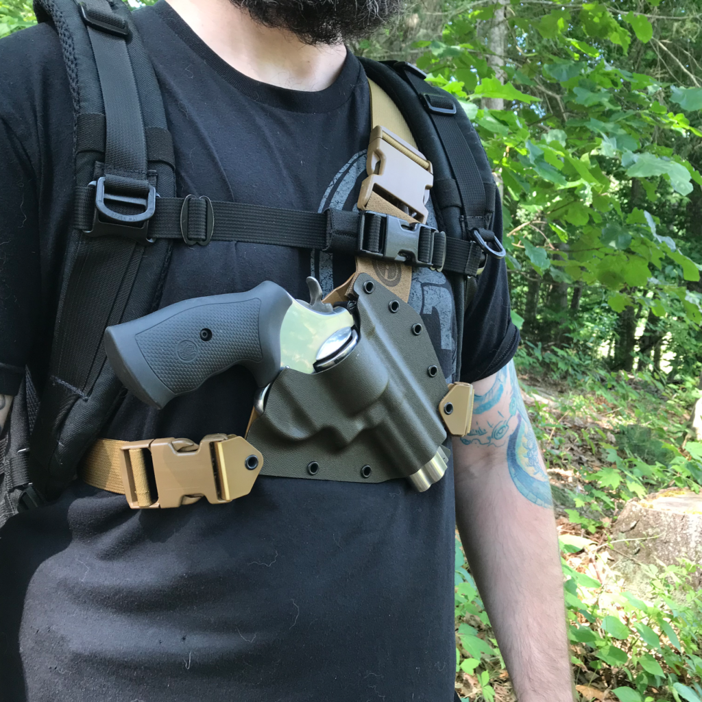 Kenai Chest Holster under a backpack