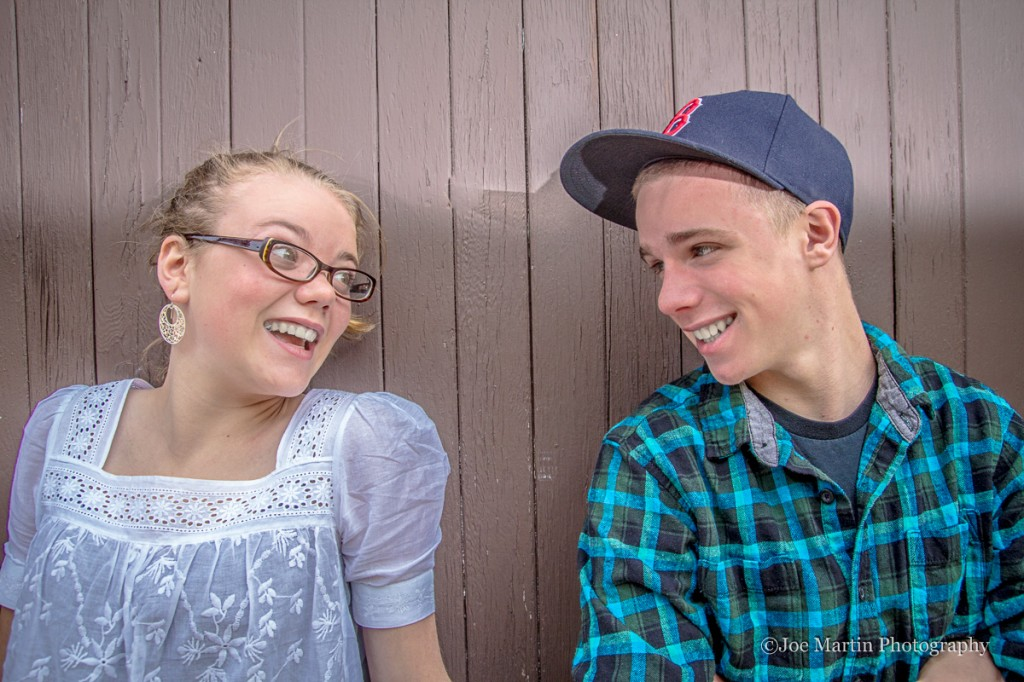 Brother and sister in a photo smiling at each other