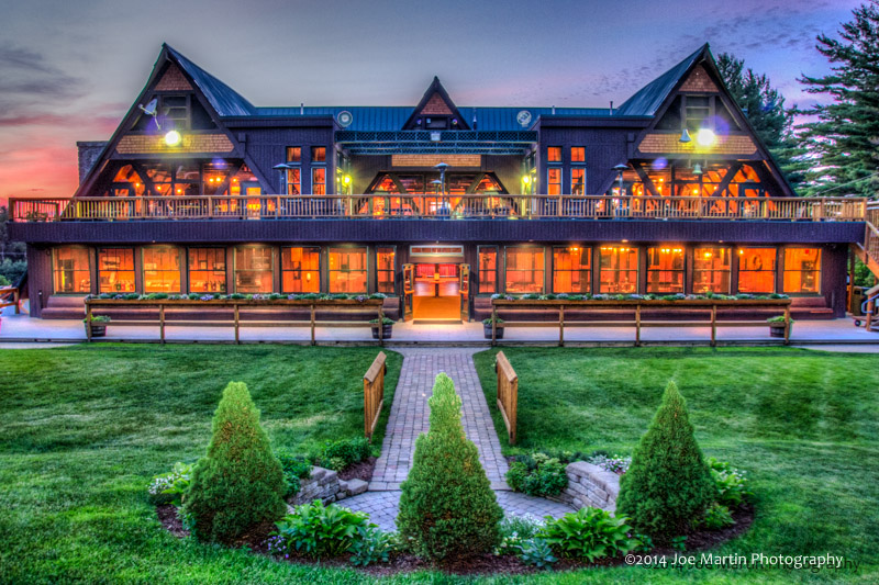 """Sunset photo of the """"Sleigh Room"""" and banquet center at Pats Peck a NH wedding venue"""