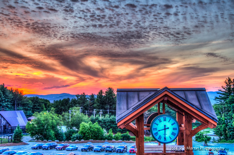Clock tower with the sunset in the background as one f southern New Hampshires wedding venues Pats Peak