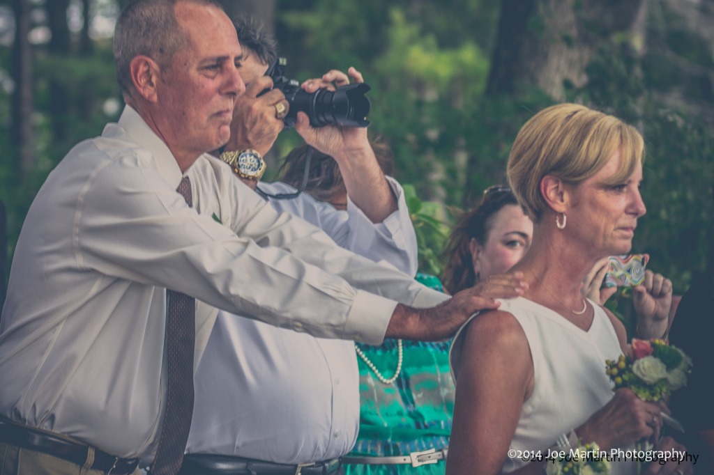 Grooms parents show emotion in this photo at the wedding