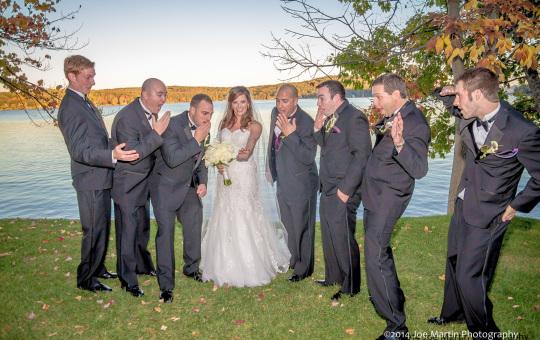Bride posing with the groomsmen