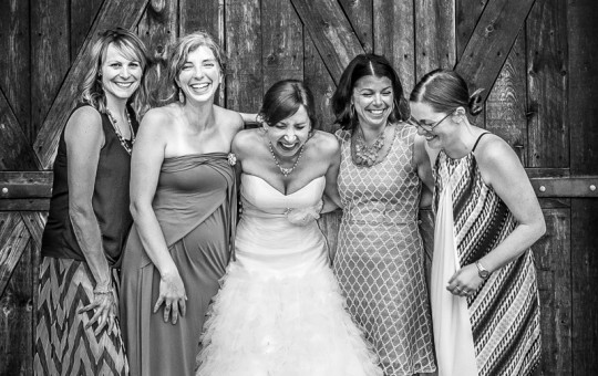 Wedding photo of the bride with some girl friends laughing