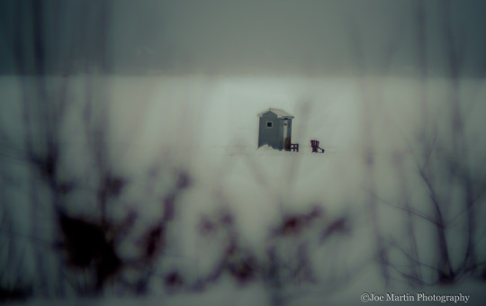 Photo of a icehouse on a frozen lake