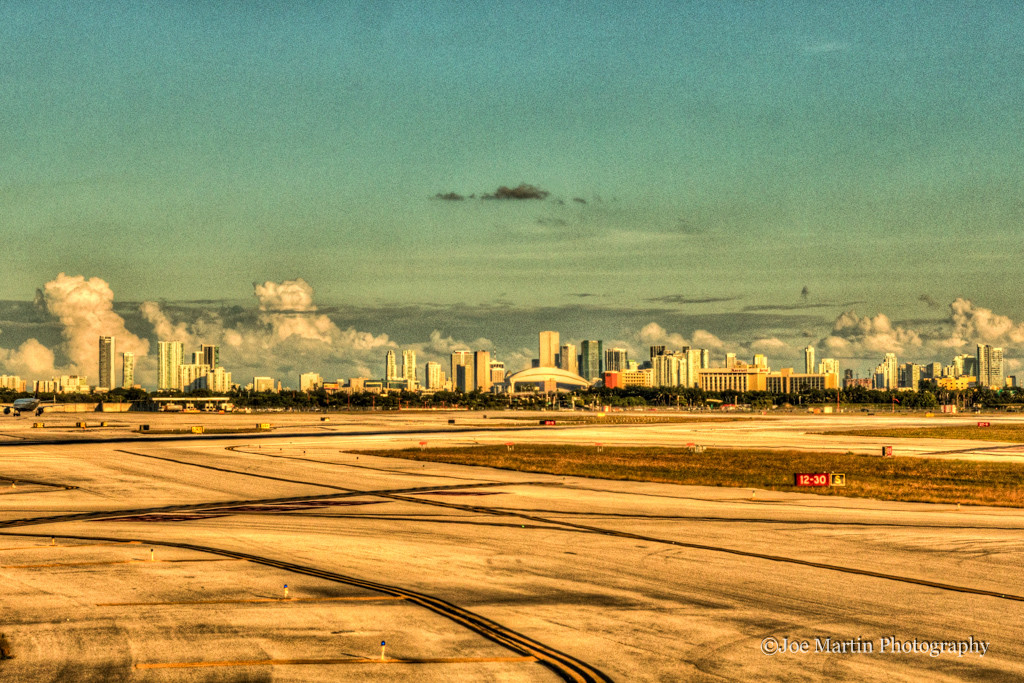 vintage looking photo of Dallas TX airport from inside a plane looking at the city