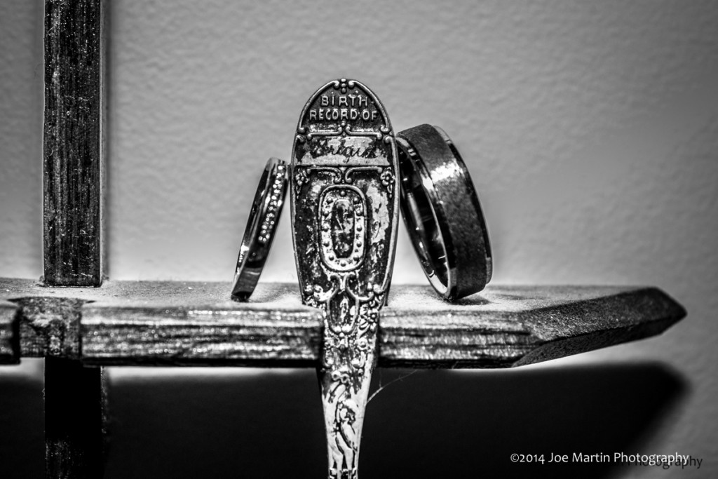 Wedding rings lean on a baby spoon that was the brides soon as a child.