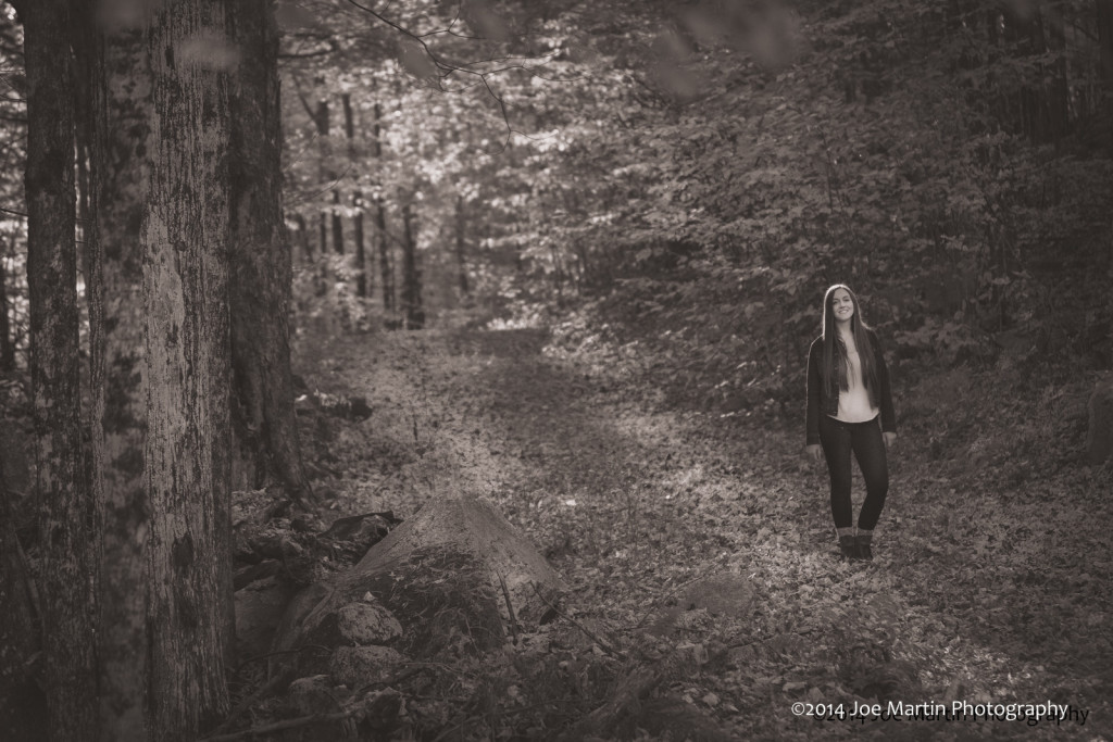 Moody photo taken in the New Hampshire woods for a senior portrait