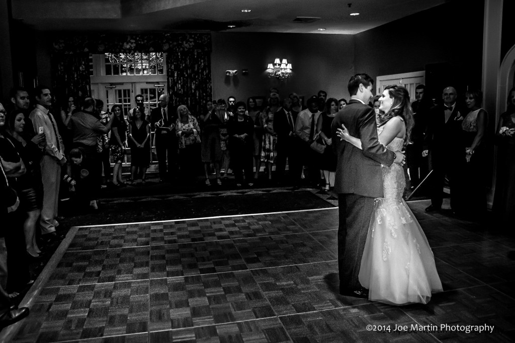 A couple dances at their wedding at Mill Falls