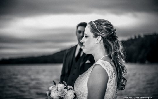 Black and white wedding portrait of a young couple at a lake in Maine after their wedding