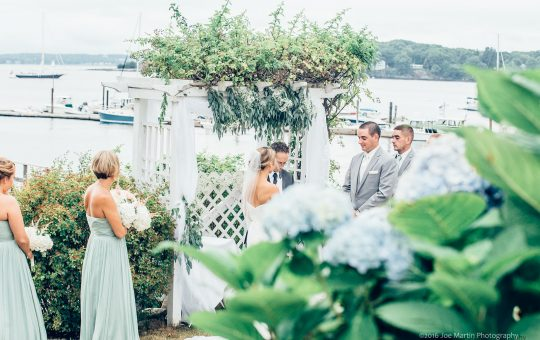 Couple being married at The Harbor View at Jones Landing