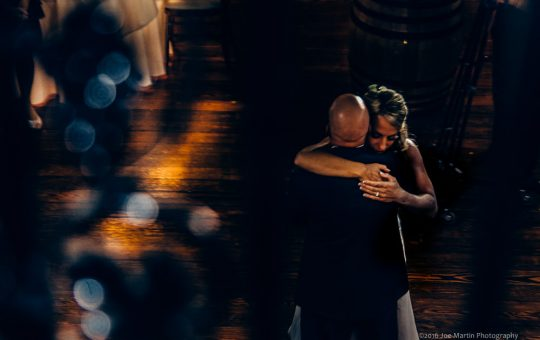 A couple hugging on the dance floor at a Zorvino Vineyards wedding