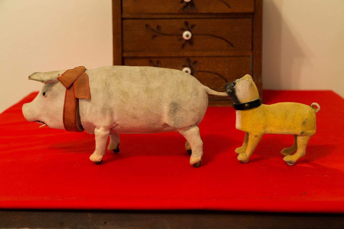 Antique toy pig and toy dog on display at the Clinton County History Center