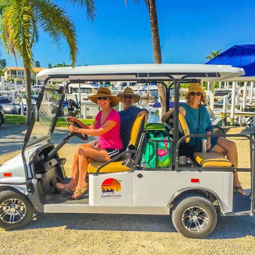 Ladies lunching in a Sanibel Cart