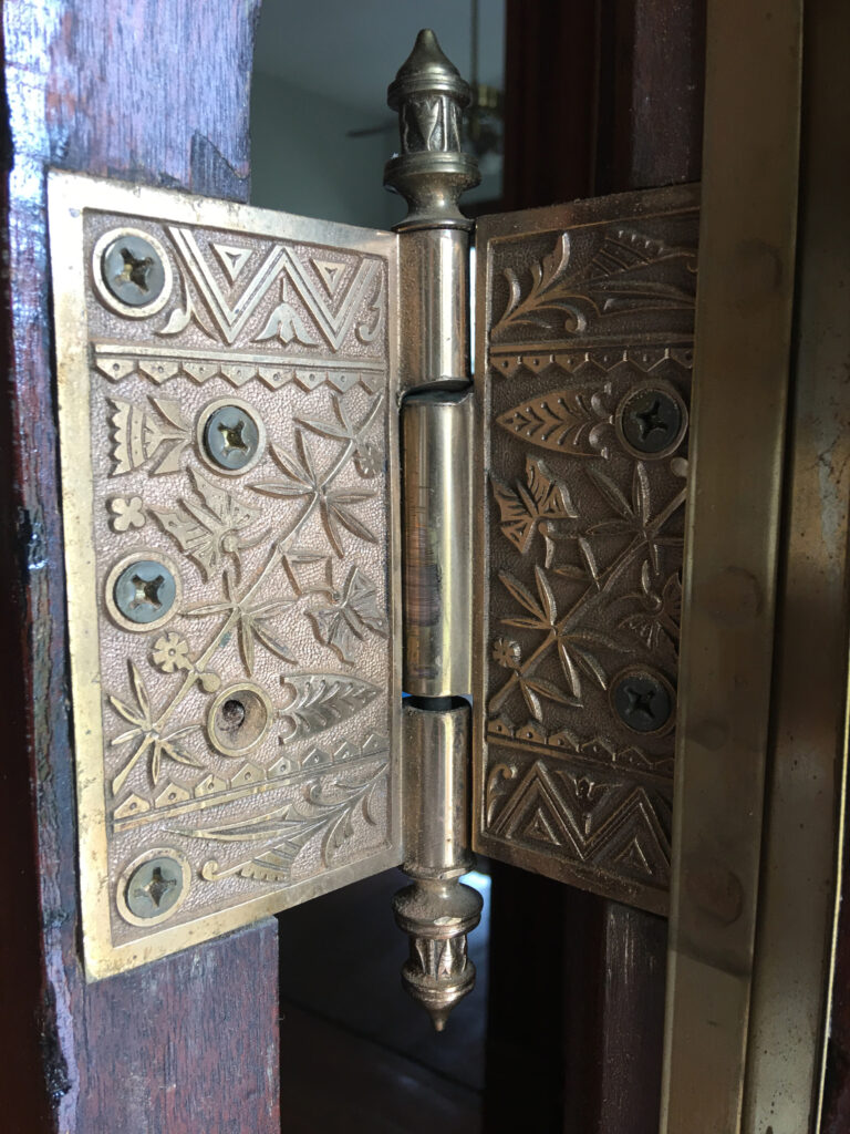 Another artfully crafted door hinge.