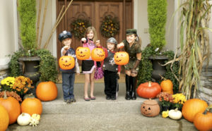Kids get dressed up in DIY Halloween costumes ready to trick-or-treat