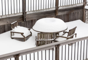 Snow piled on patio furniture left outside during the winter
