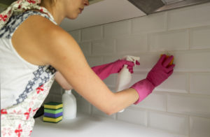 A woman spring cleaning her home