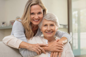 A woman hugging her senior mom