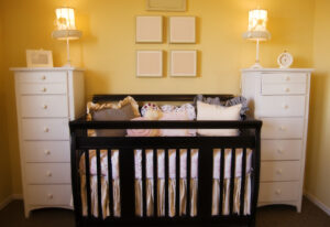A nursery before storing baby clothes and gear in a storage unit