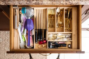 A kitchen draw that has been organized neatly
