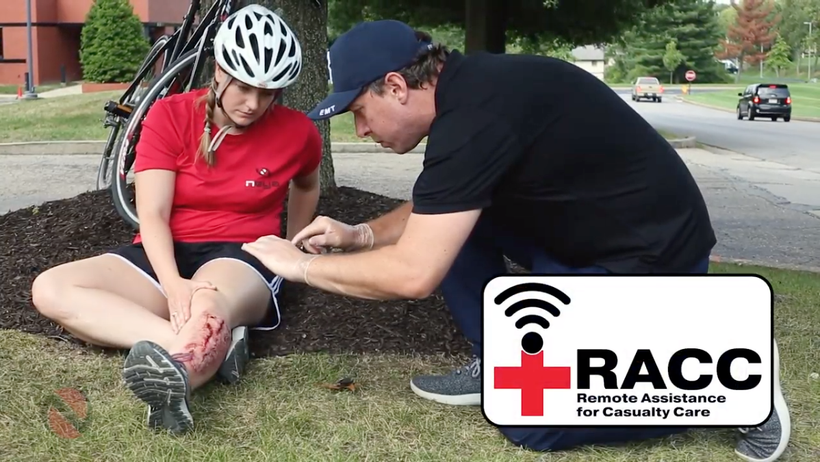 EMT assisting injured individual using Neya's RACC software