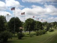Flag poles fly the American flag at Centennial Park