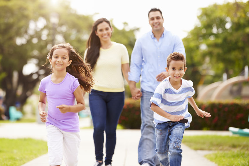 Hispanic Family Walking in the park